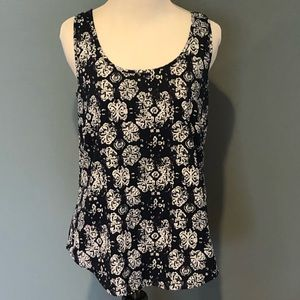 Blue tank top with white print.